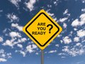 Are you ready yellow highway sign with the question in black with question mark against blue sky and clouds Stock Images