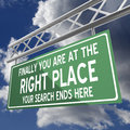 You are at the right place words on road sign green Royalty Free Stock Image