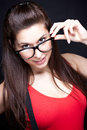 Are you smart enough for me geek woman in red beautiful holding black glasses Royalty Free Stock Image