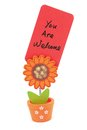 You are welcome words written on red paper of sun flower pot clip Royalty Free Stock Photos