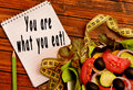 You are what you eat written on notebook Stock Photos
