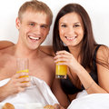 Youg couple drinking juice Stock Photo
