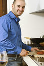Yougn man in the kitchen Royalty Free Stock Photo