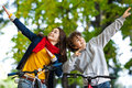 Young active people biking girl and boy in city park Stock Images