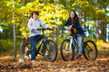 Young active people biking girl and boy in city park Royalty Free Stock Photography