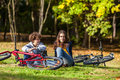 Young active people biking girl and boy in city park Royalty Free Stock Image