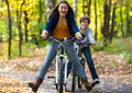Young active people biking girl and boy in city park Stock Image