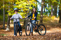 Young active people biking girl and boy in city park Royalty Free Stock Photo