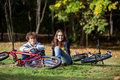 Young active people biking girl and boy in city park Stock Photos