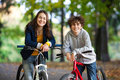 Young active people biking girl and boy in city park Stock Photo