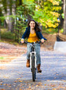 Young active people biking girl in city park Royalty Free Stock Photo