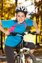 Young active people biking girl in city park Stock Image