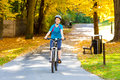 Young active people biking girl in city park Royalty Free Stock Photography