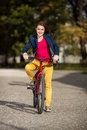Young active people biking girl in city park Royalty Free Stock Images