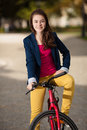 Young active people biking girl in city park Stock Photography