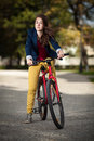 Young active people biking girl in city park Royalty Free Stock Photos
