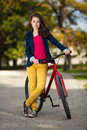 Young active people biking girl in city park Stock Photos
