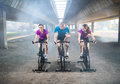 Young activity people exercising spin bike Royalty Free Stock Photo