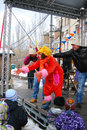 Young actress inviting childred stage to join two man participate contest shrovetide celebration moscow city center taken march Royalty Free Stock Photo