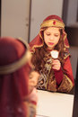 Young actress looking herself in mirror girl pricess costume Stock Image