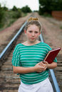 Young adolescent on tracks Royalty Free Stock Images
