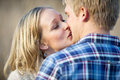 Young adult couple kissing outside in daytime caucasian Royalty Free Stock Photography