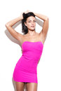 Young adult fashionable woman in pink dress Royalty Free Stock Photo