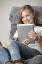 Young adult female reading on a tablet pc Royalty Free Stock Image