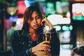 Young adult girl in a club drinking beer alone Royalty Free Stock Photo