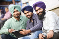 Young adult indian sikh men group portrait of smiling authentic native punjabi in turban with bushy beard Royalty Free Stock Image