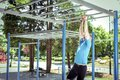 Exercise on monkey bars in park Royalty Free Stock Photo