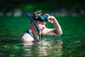 Young adult snorkeling in a river with goggles and scuba Royalty Free Stock Photography