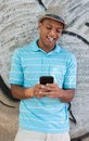 Young adult using a tablet pc pda leaning against wall with graffitis Stock Photos