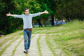 Young adult walking alone in park Royalty Free Stock Photo