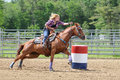 Young adult woman galloping around a turn in a barrel race Royalty Free Stock Photo