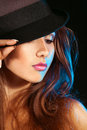 Young adult woman in hat studio on black background Royalty Free Stock Image