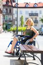 Young adult woman on wheelchair on the street Royalty Free Stock Photo