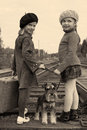 Young adventurer two girls and a dog go by rail Royalty Free Stock Photography
