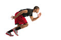 Young african american athlete sprinting isolated on white background Stock Photos