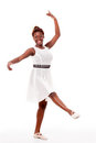 Young african-american ballet dancer in developpé Royalty Free Stock Photos