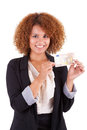 Young african american business woman holding a euro bill afri isolated on white background people Stock Photo