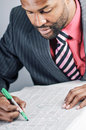 Young African American Businessman Being Sneaky On Laptop Royalty Free Stock Photo