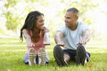Young African American Couple Exercising In Park Royalty Free Stock Photo