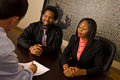 Young african american couple to sign papers contract Stock Photos