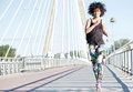 Young african american girl running. Royalty Free Stock Photo