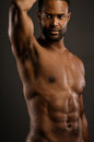 Young african american man body pose a flexing his Royalty Free Stock Image