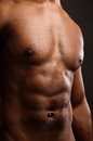 Young african american man flexing abdomen a his abdominal muscles studio shot Royalty Free Stock Images