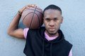 Young african american man holding basketball close up portrait of a handsome Stock Photo