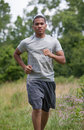 Young African American Man Jogging in the Woods Royalty Free Stock Photo