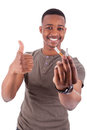 Young african american man showing  a broken  cigarette Stock Image